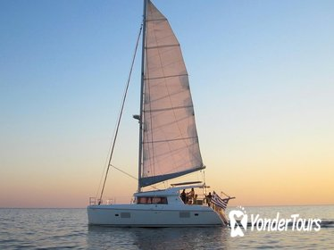 Caldera Catamaran Gold Sunset Cruise with Meal and Drinks