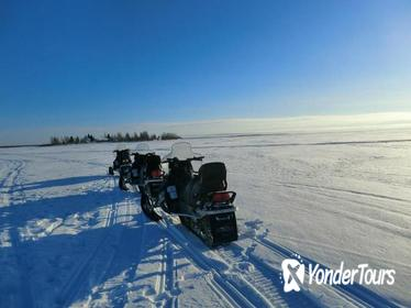 Snowmobile Safari in the Arctic Circle with Hotel Transport from Rovaniemi