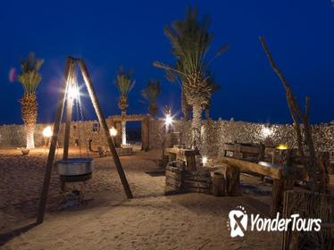 Overnight Desert Camp Experience: Dinner, Emirati Activities, and Vintage Land Rover Transport from Dubai
