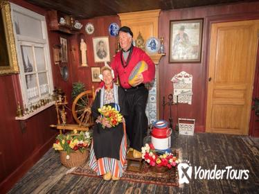 Picture in traditional Volendam costume and One-day bus ticket from Amsterdam